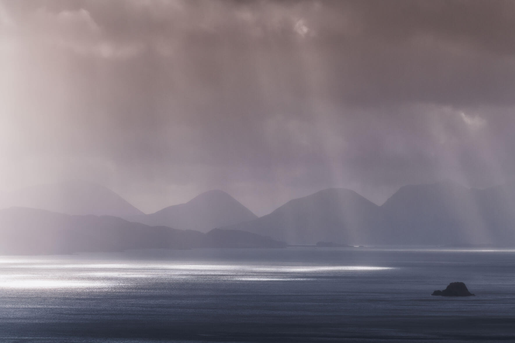 Sunbeams after rain shower over the Isle of Skye in Scotland