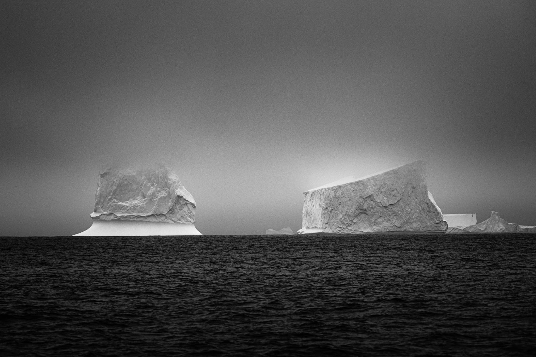 Tabular icebergs in the Gerlache Strait of Antarctica in black and white
