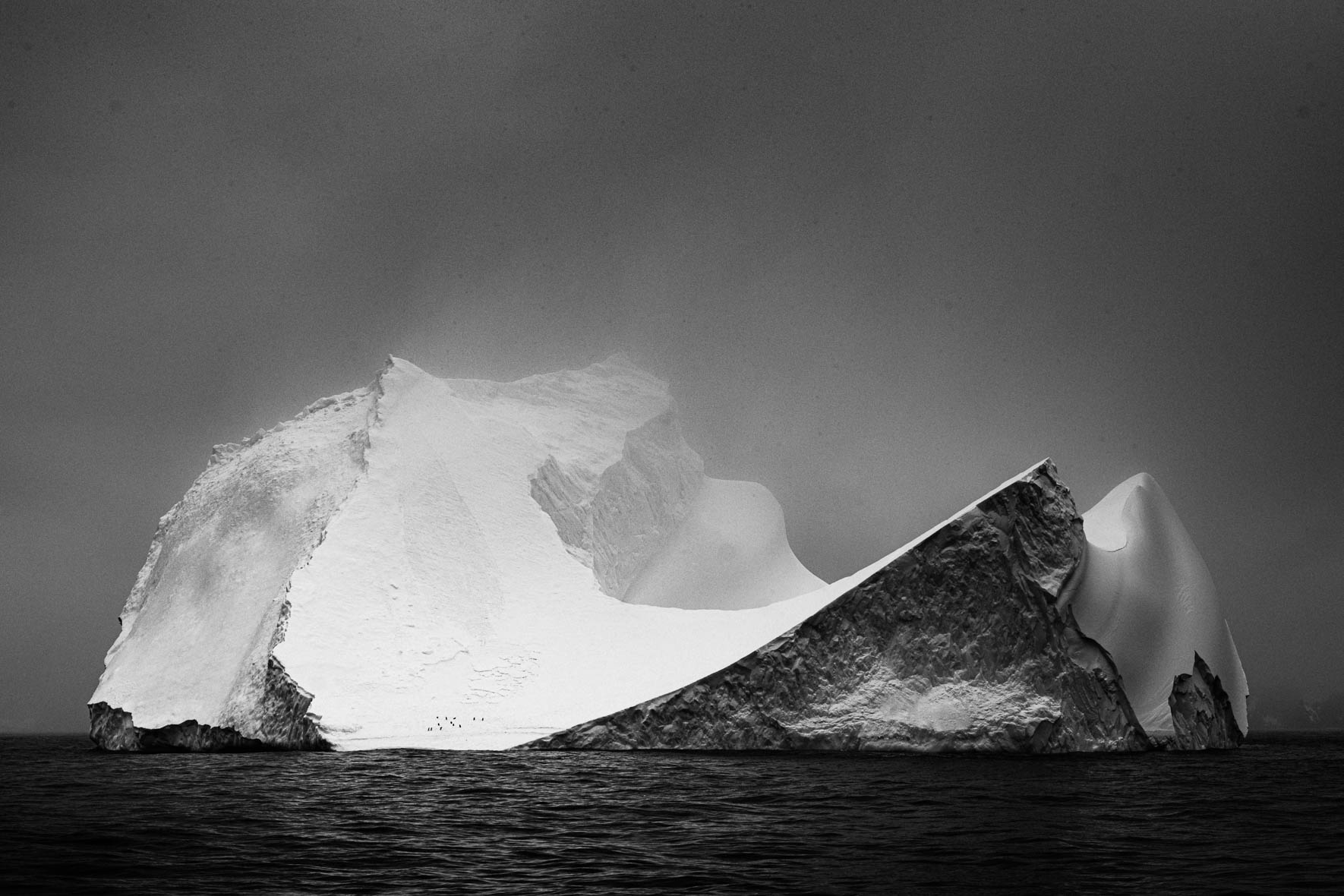 Tabular iceberg in Antarctica in black and white