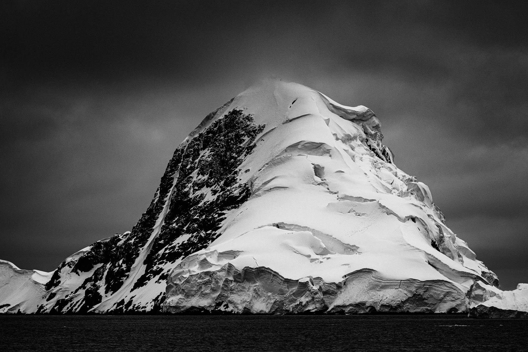 Black and white photo of glacier and mountain in Antarctica