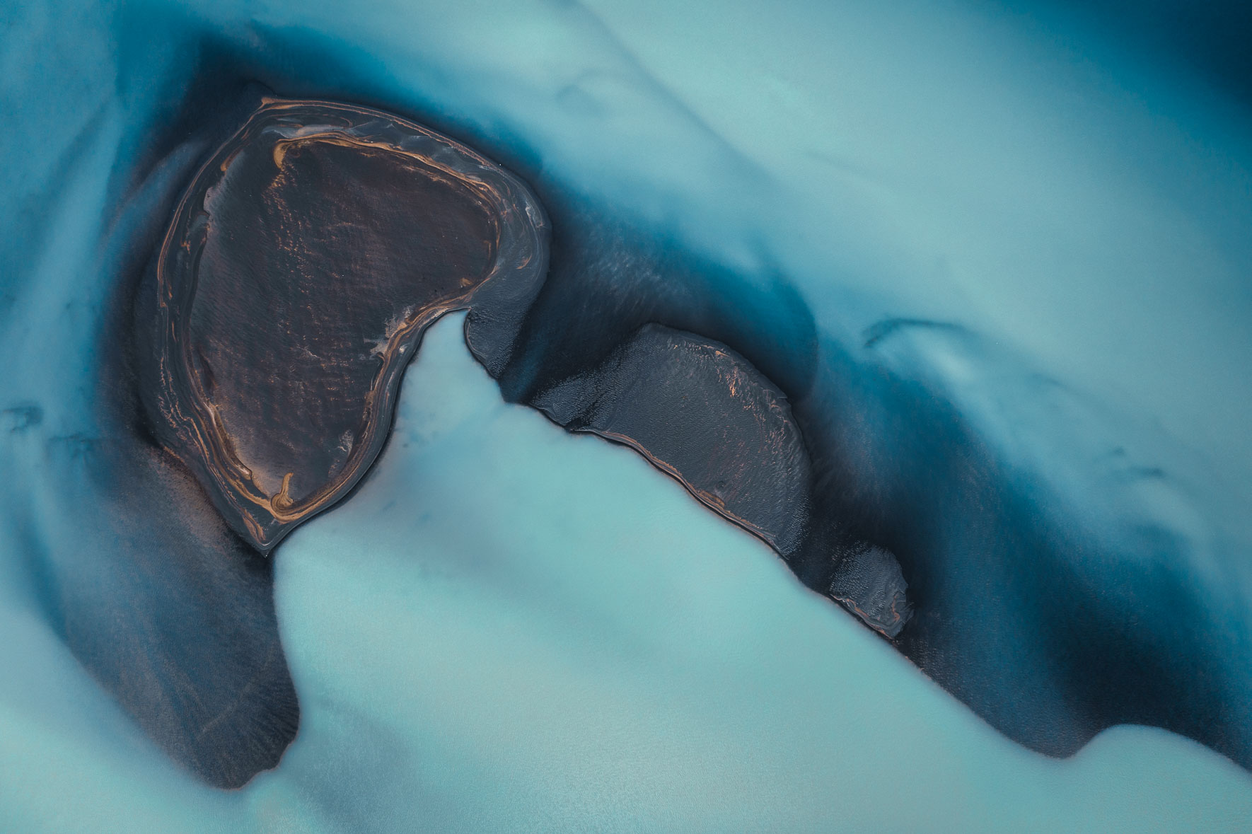 Abstract aerial photography of glacier river in Iceland