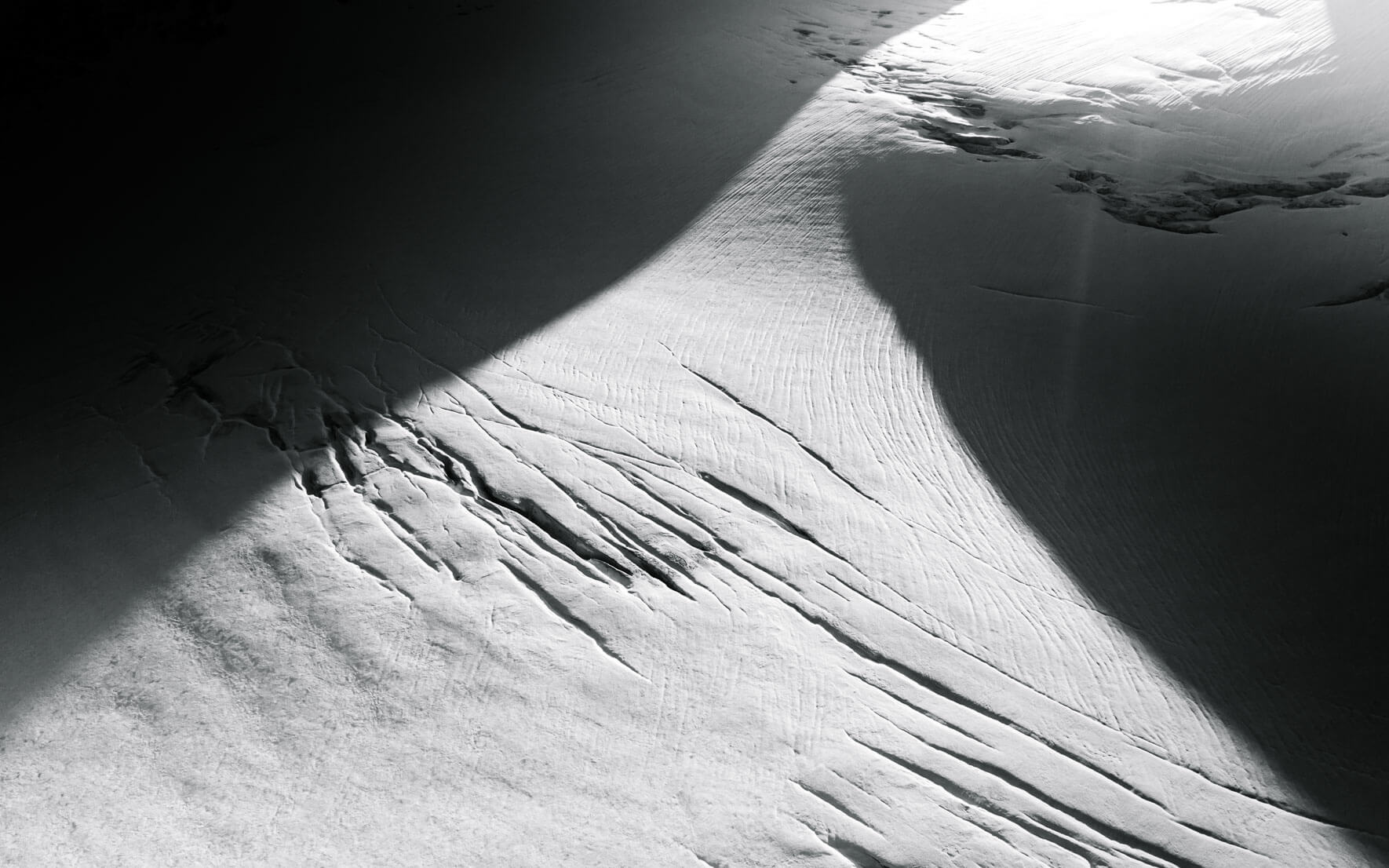 Glacier with glacial crevasses in black and white
