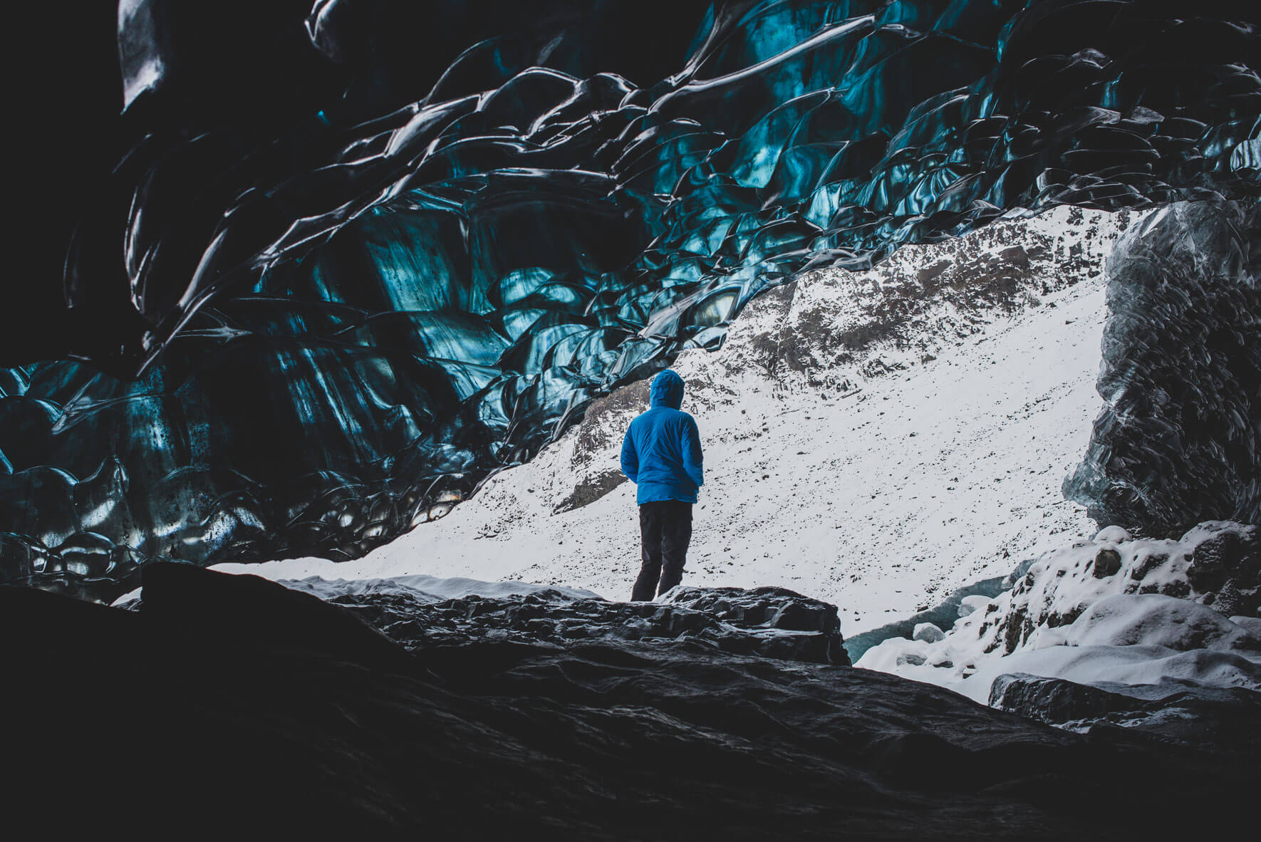 Winter fashion shooting in glacier cave in Iceland