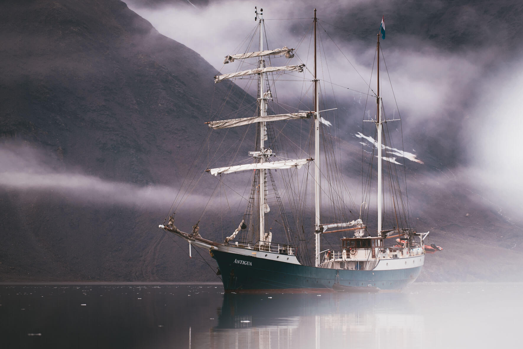 Three-mast sailing ship Antigua in the waters of Svalbard