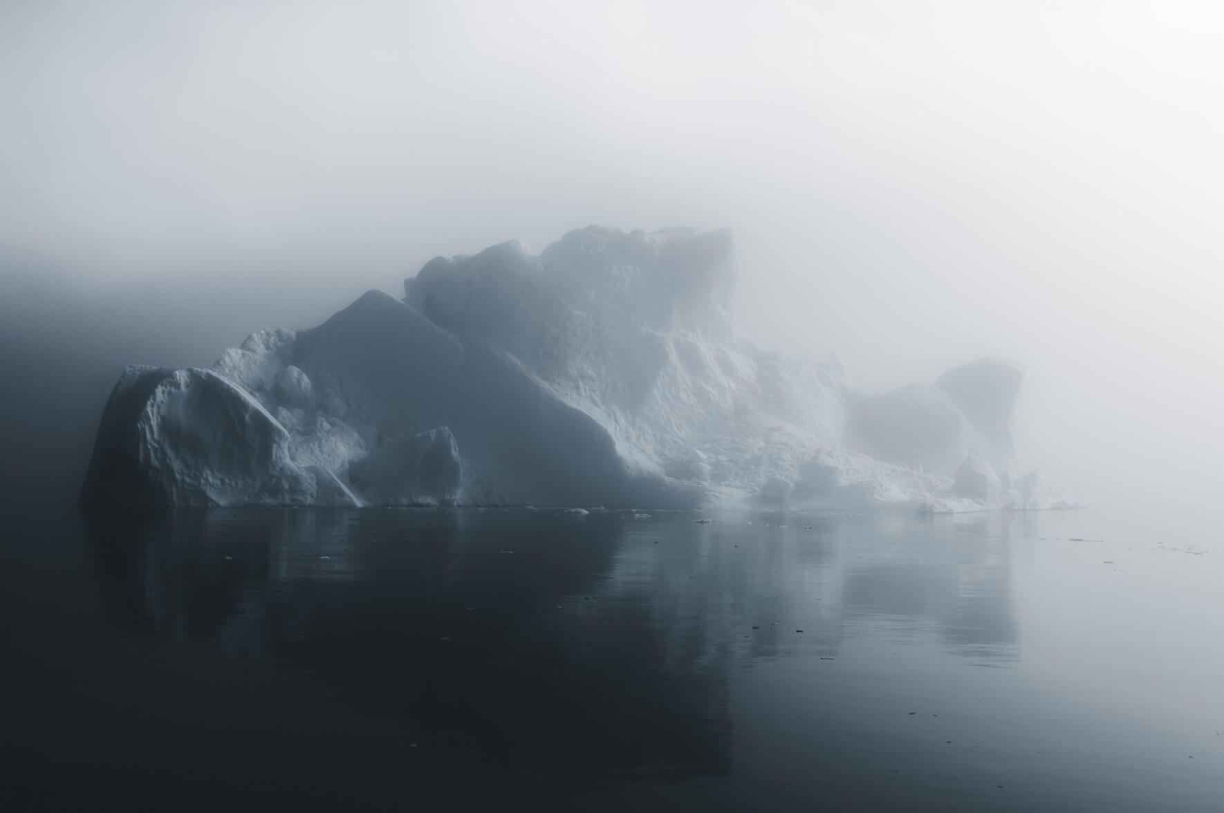 Arctic seascape with iceberg in fog (Disko Bay, Greenland)