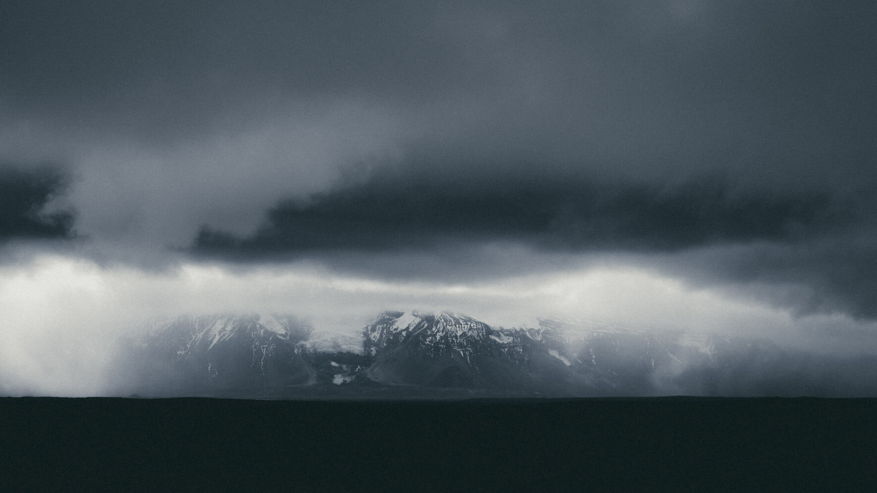 Dramatic clouds over Langjökull glacier and mountain range in Iceland