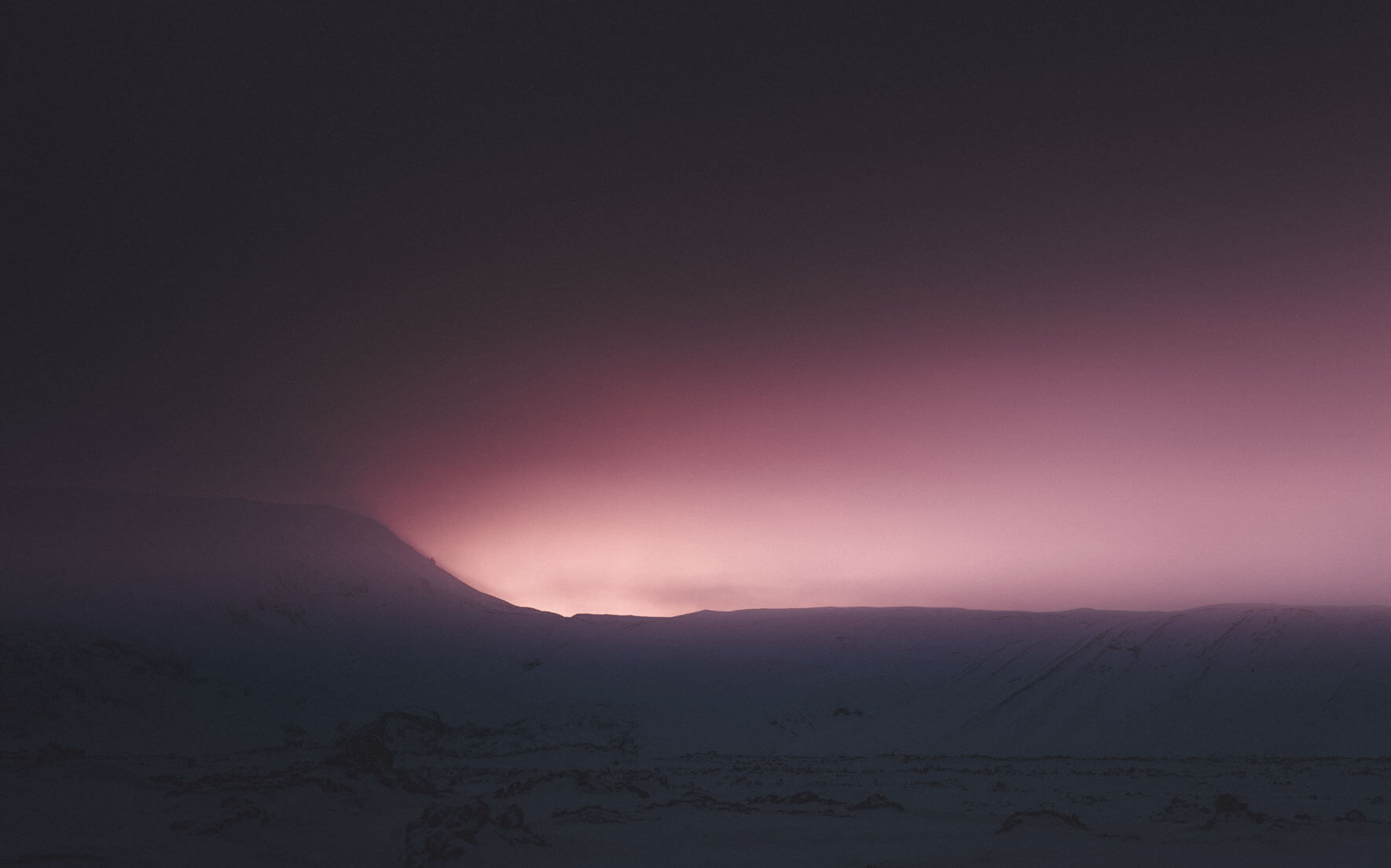 Sunset over the mountains in Iceland in winter