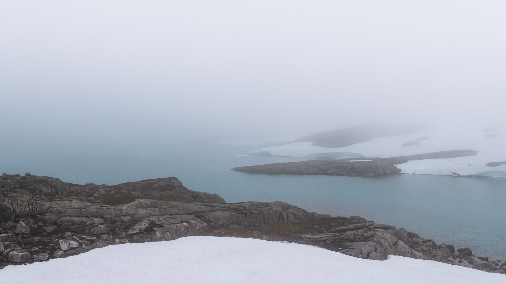 Lake in the clouds along the Gamle Strynefjellsvegen in Norway