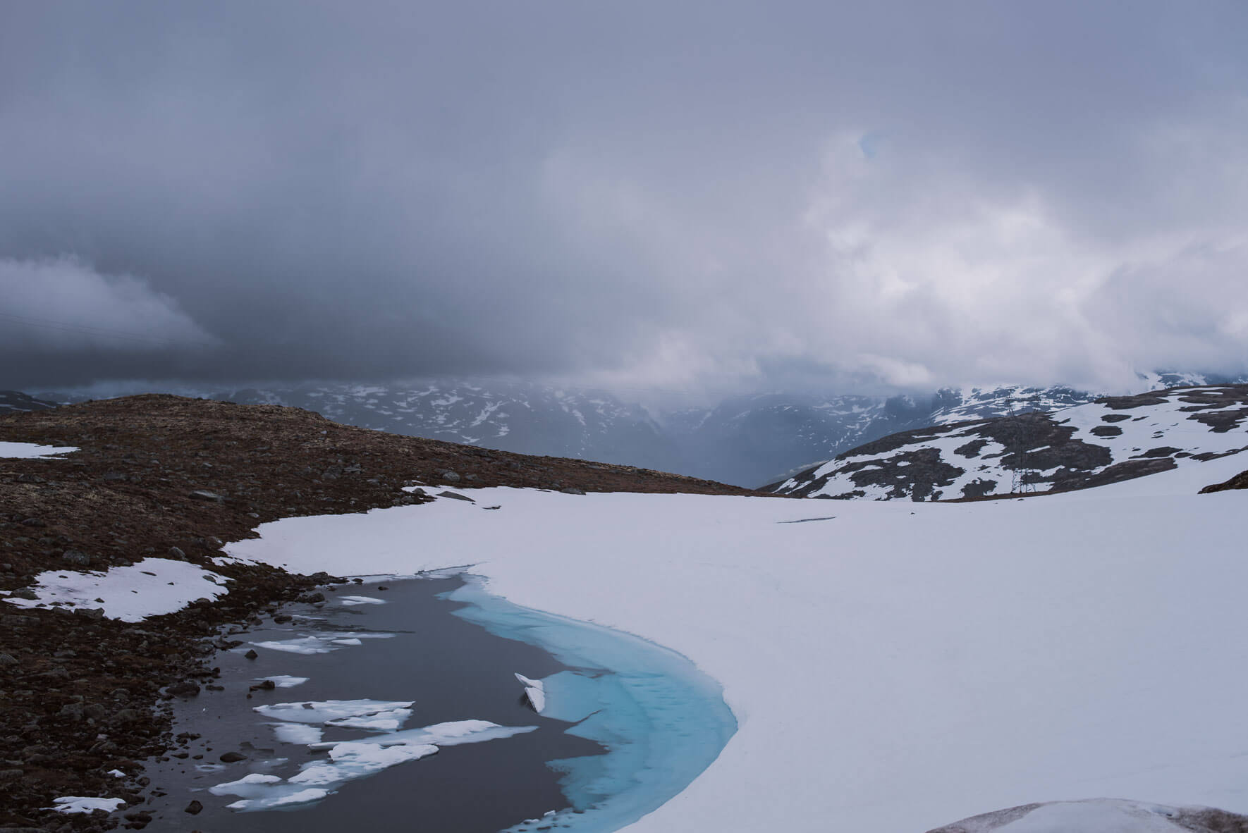 Frozen lake on the Snøvegen in Norway crossing the Aurlandsfjellet mountains